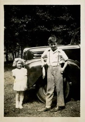 Clair with a fish and his sister Sharon